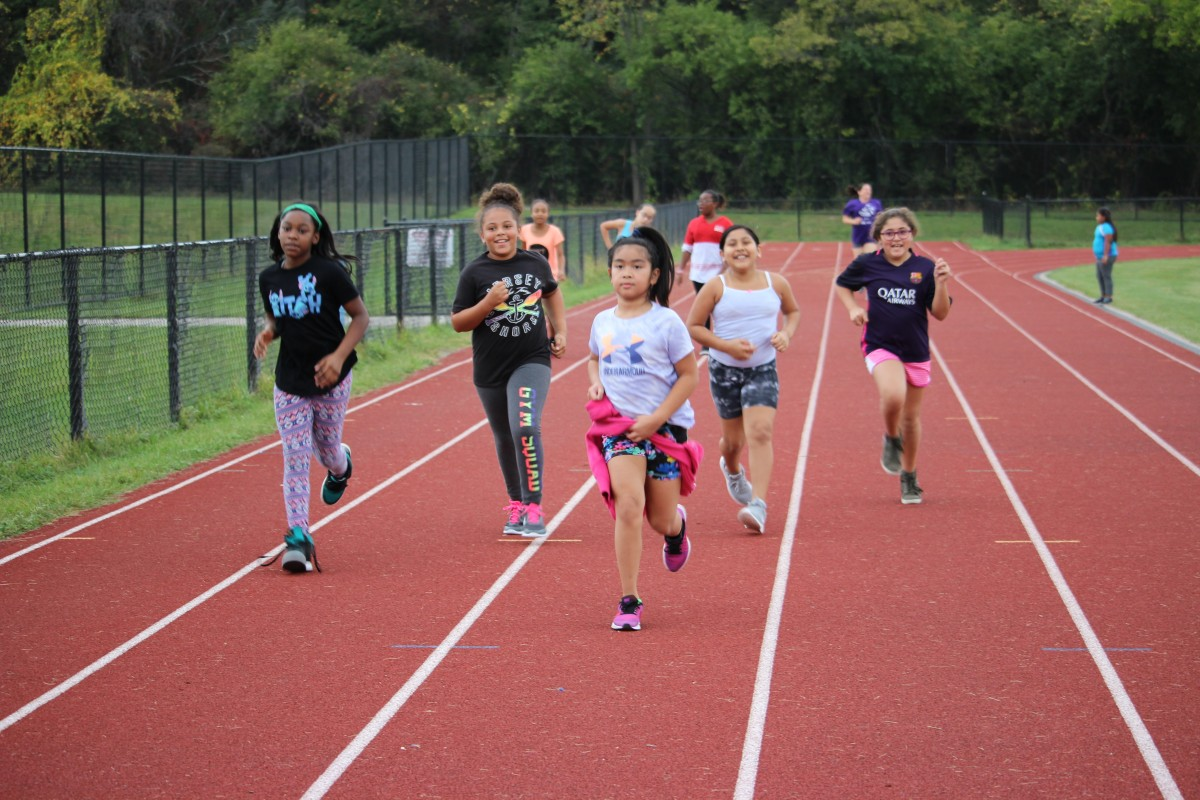 Girls running on track 1