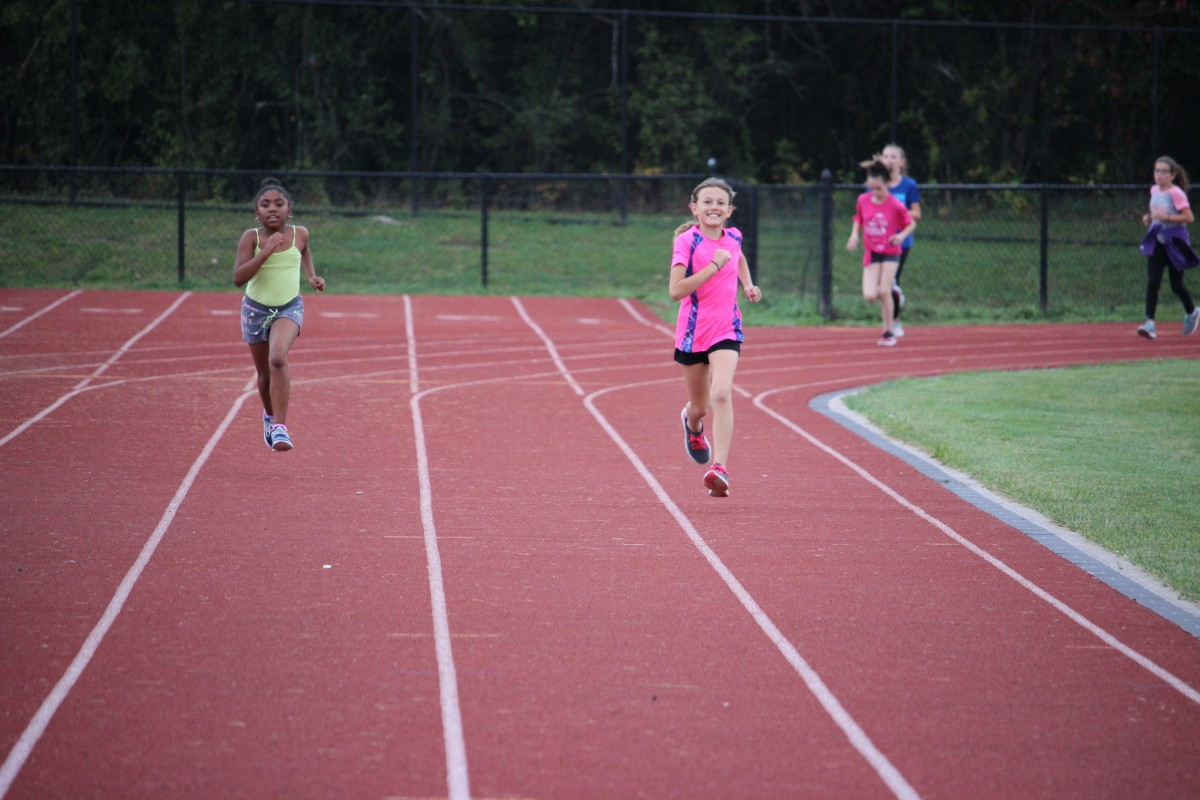 Girls running on track 2