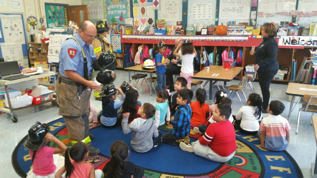 Firefighter talking to students in classroom 1