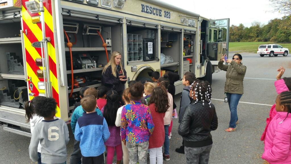 Students looking inside firetruck