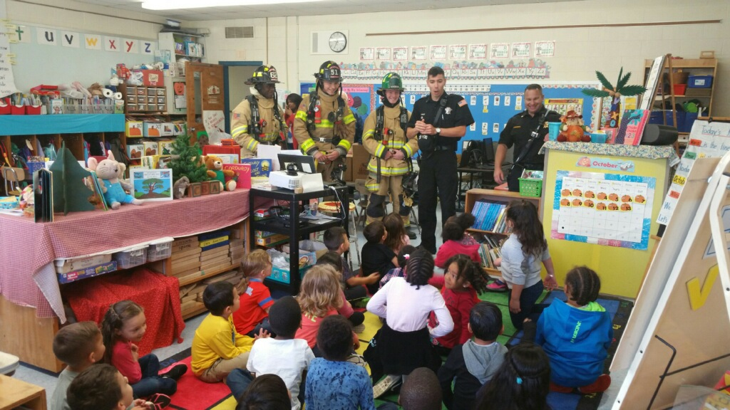 Firefighter talking to students in classroom 2