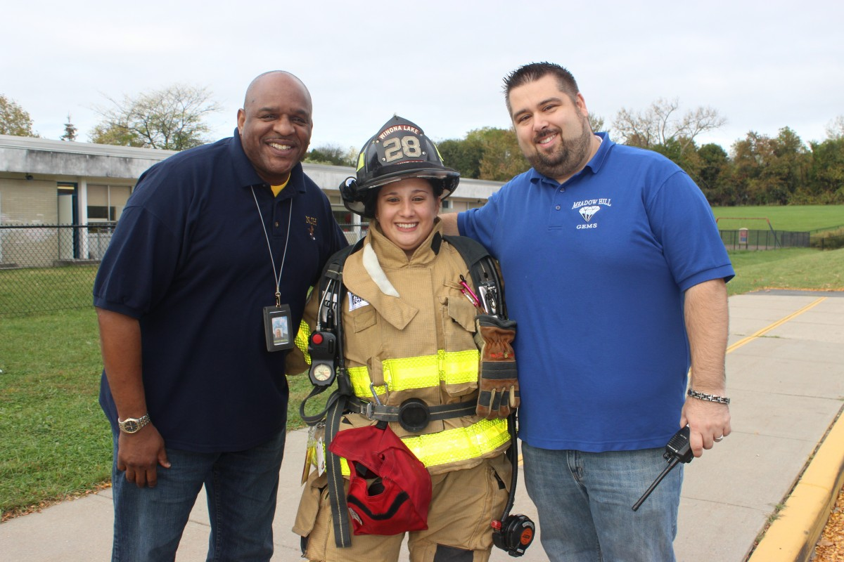 Administrators with firefighter