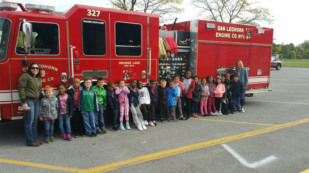 Students standing in front of firetruck