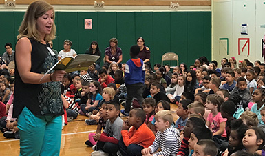 Author talking to group of students.