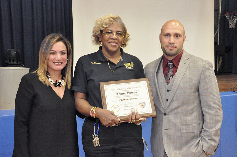 Security Guard Regina Brown with Principal and Superintendent