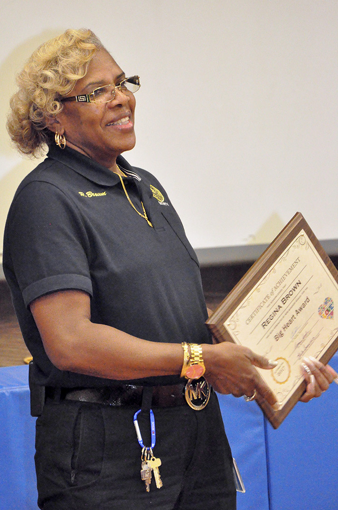 Security Guard Regina Brown with award