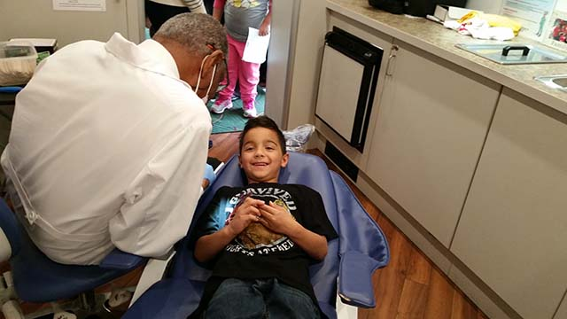 The dentist discusses dental hygiene with students