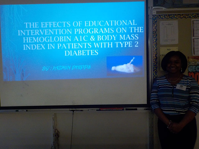 Jazmin Phipps standing in front of her presentation