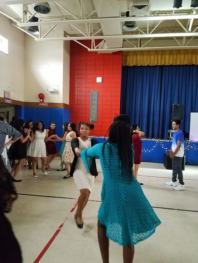 Students dancing at the celebration