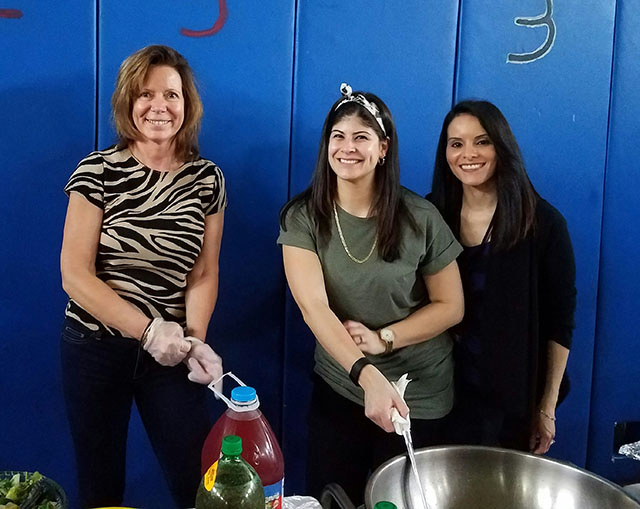 Teachers serving food at the celebration