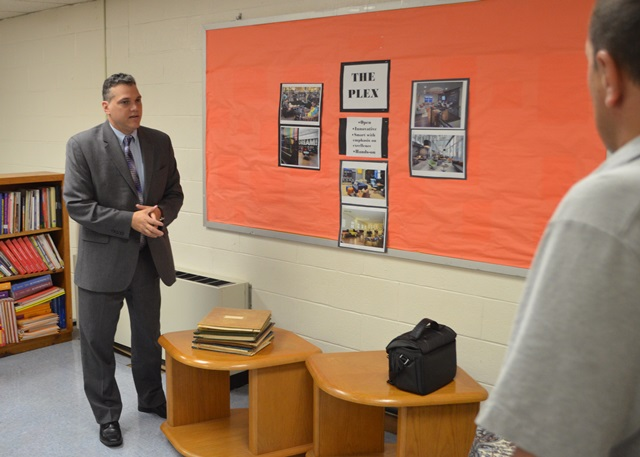 Principal Lopez discussing the lab.