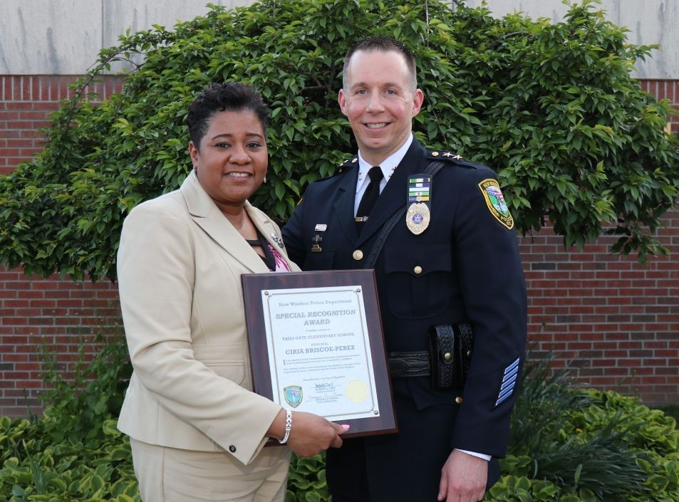 Mrs. Briscoe-Perez stands with Chief Robert Doss.