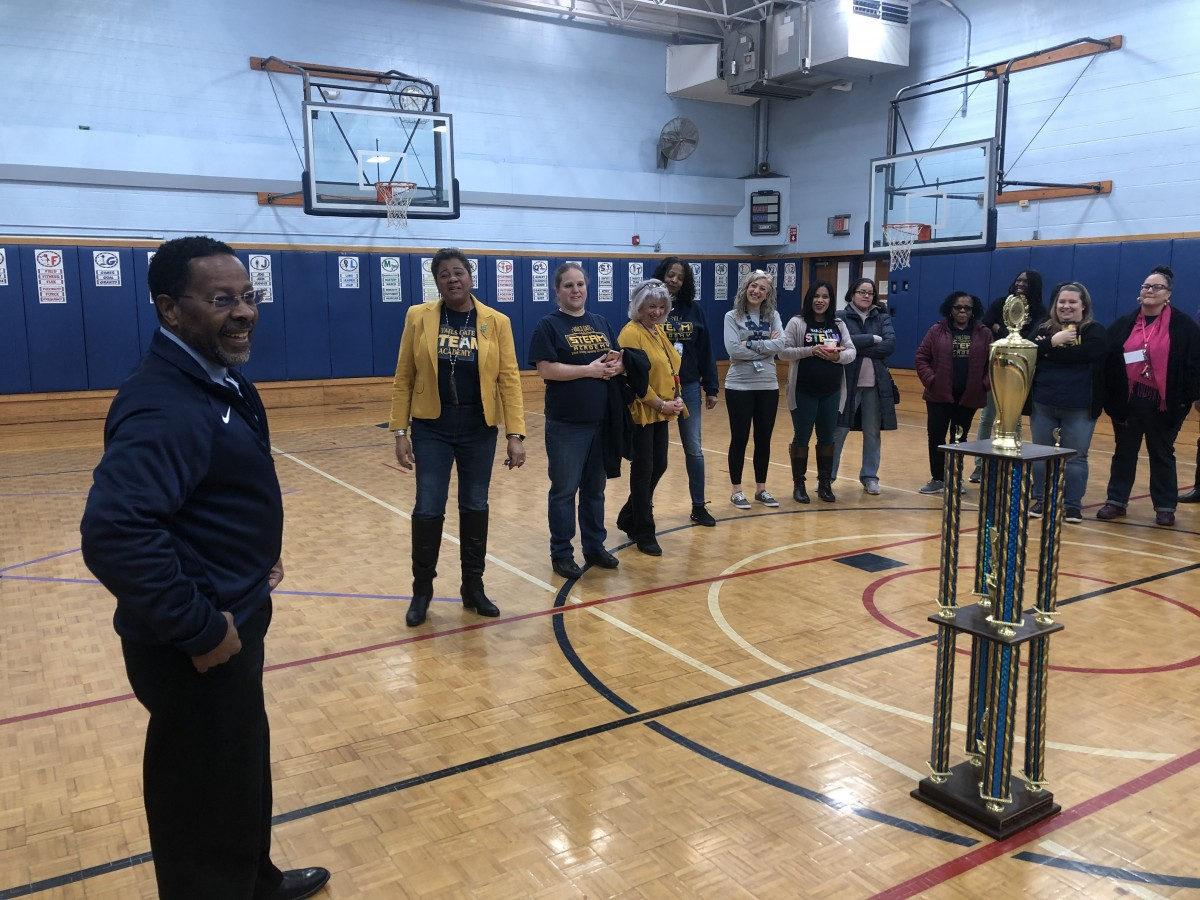 Assistant Superintendent of Human Resources, Mr. Michael McLymore addresses the group before handing out the trophy.