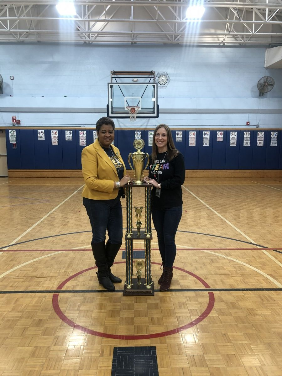 Building principal Mrs. Ciria Briscoe-Perez and Assistant Principal, Ms. Eileen Cruz pose for a photo with the Attendance Trophy.